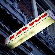 Jam illuminated sign on building facade, London, England (September 2007)