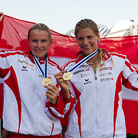 Yvonne Schuring (L) and Viktoria Schwarz (R) from Austria celebrate their victory in the K2 women Kayak 500m final of the 2011 ICF World Canoe Sprint Championships held in Szeged, Hungary on August 20, 2011. ATTILA VOLGYI