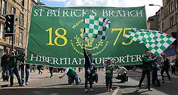 Hibernian Scottish Cup Open Top Bus Edinburgh 14 May 2016; Hibs fans follow the bus down Leith Walk during the open top bus parade in Edinburgh after winning the Scottish Cup.<br /> <br /> (c) Chris McCluskie | Edinburgh Elite media