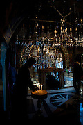 Church of the Holy Sepulchre, in the Christian quarters, Jerusalem, Israel, pilgrim lights a candle