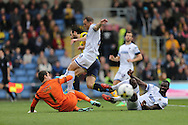 James Shea, AFC Wimbledon defender Barry Fuller (2) and AFC Wimbledon defender Karleigh Osborne (22) clear the ball during the Sky Bet League 2 match between Oxford United and AFC Wimbledon at the Kassam Stadium, Oxford, England on 10 October 2015.