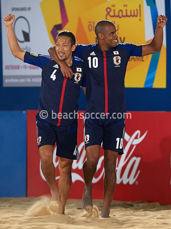 DOHA, QATAR - JANUARY 24:  Moreira Ozu (R)of Japan celebrates with his teammate Makino Shinji during the FIFA Beach Soccer World Cup 2013 Qualifier Qatar at Katara Beach on January 24, 2013 in Doha, Qatar. (Photo by Manuel Queimadelos)