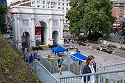 Visitors to the Marble Arch Mound climb steps up towards the top, on 11th August 2021, in London, England.