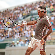 PARIS, FRANCE June 04. The split second the ball and racquet meet as Roger Federer of Switzerland plays a shot against Stan Wawrinka of Switzerland on Court Suzanne Lenglen during the Men's Singles Quarter Final match at the 2019 French Open Tennis Tournament at Roland Garros on June 4th 2019 in Paris, France. (Photo by Tim Clayton/Corbis via Getty Images)