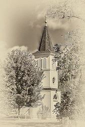 A Church Steeple Rises In The Distance