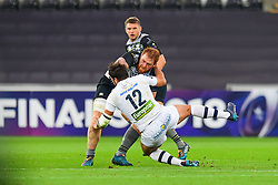 Ospreys' Dan Baker is tackled by Clermont Auvergne's Remi Lamerat - Mandatory by-line: Craig Thomas/JMP - 15/10/2017 - RUGBY - Liberty Stadium - Swansea, Wales - Ospreys Rugby v Clermont Auvergne - European Rugby Champions Cup
