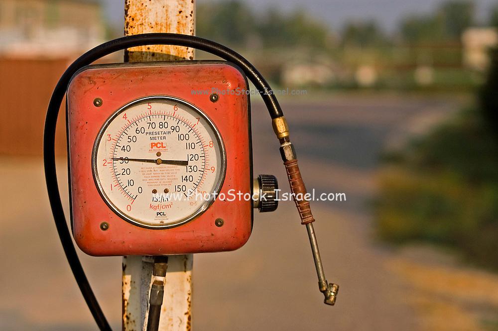 A motorcar air pump at a gas station, Israel