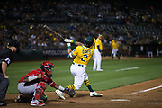 Oakland Athletics designated hitter Khris Davis (2) bats against the Los Angeles Angels at Oakland Coliseum in Oakland, California, on September 5, 2017. (Stan Olszewski/Special to S.F. Examiner)