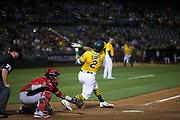 Oakland Athletics designated hitter Khris Davis (2) bats against the Los Angeles Angels at Oakland Coliseum in Oakland, California, on September 5, 2017. (Stan Olszewski/Special to S.F. Examiner)