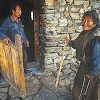 An elderly couple outside their house in the Tsangpo River Gorge, one of the world's deepest canyons, in remote southeastern Tibet, China.