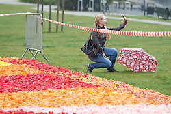 May 6, 2017 - Bydgoszcz, Poland - A young woman is seen taking a selfie with the flower carpet made from tulips on the Mill Island in Bydgoszcz, Poland on 6 May, 2017. (Credit Image: © Jaap Arriens/NurPhoto via ZUMA Press)