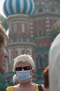 Moscow, Russia, 04/08/2010. .Tourists wear masks to cover their faces against intense smog in Red Square in the record high temperatures of the continuing heatwave. Peat and forest fires in the countryside surrounding Moscow have resulted in the Russian capital being blanketed in heavy smog.