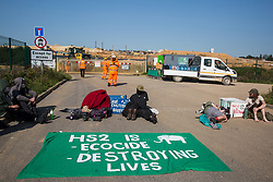 Environmental activists from HS2 Rebellion use lock-on arm tubes to block a gate to the South Portal site for the HS2 high-speed rail link on 14 September 2020 in West Hyde, United Kingdom. Anti-HS2 activists blocked two gates to the same works site for the controversial £106bn rail line, one remaining closed for over six hours and another for over nineteen hours.