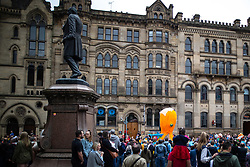 © Licensed to London News Pictures . 17/06/2018. Manchester , UK . The 2018 Manchester Day parade , celebrating Manchester's cultural and social life and diversity, passes through Manchester City Centre . Photo credit : Joel Goodman/LNP