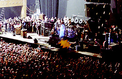 Bill Graham as Father Time arrives at the Stage for the Grateful Dead on New Years Eve at the Stroke of Midnight. The Dead in Concert at the San Francisco Civic Auditorium, 31 December 1984 into 1 January 1985. Just as the Third Set Begins. Shot on Color Negative Film, Kodak CM135-36.