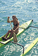 Polynesian woman on outrigger canoe, Hawaii<br />