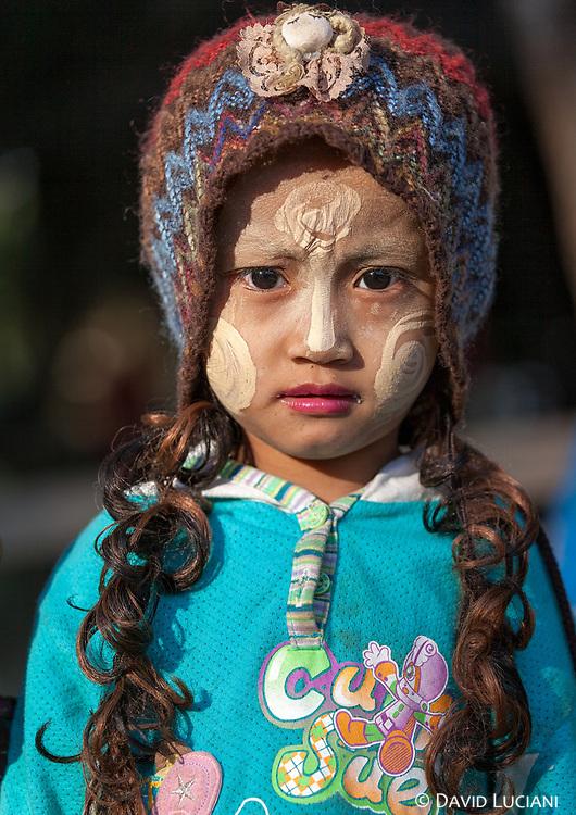 Portrait of a Chin girl taken in a village near Lemro River.