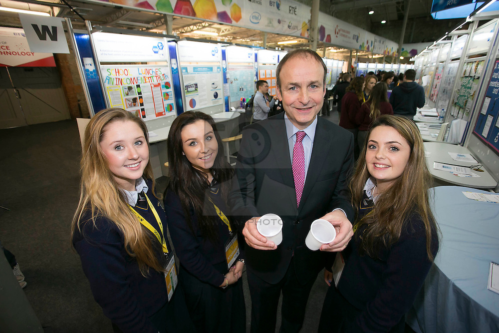"""Repro Free: 08/01/2014 <br /> Fianna Fail leader Micheál Martin TD is pictured with Sinead McCarthy, Ciara Mullane and Rachel Reidy from Salesian Secondary College, Limerick ans their project """"Fight Fluoride!"""" at the BT Young Scientist & Technology Exhibition 2014 in the RDS Dublin. Picture Andres Poveda"""