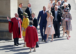 James Haskell and Chloe Madeley (centre) arrive for the wedding of Prince Harry and Megan Markle at Windsor Castle.