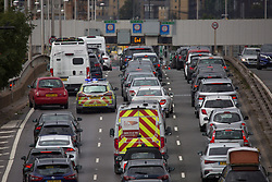 © Licensed to London News Pictures.  29/08/2021. London, UK. Traffic builds up on the A102 northbound in Greenwich, south London. Drivers have been warned to expect heavy ank holiday traffic. Photo credit: Marcin Nowak/LNP
