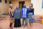 VSO ICS volunteers Francisca Mlingwa and Josie Kearney with Mr Abdul Issa Makolela and Mrs Muhunda A.Uwesa in their host home. Volunteers stay with local families get the full experience. Lindi, Lindi region. Tanzania.