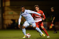 Coventry City's Franck Moussa and Leyton Orient's Gary Sawyer in action - Photo mandatory by-line: Mitchell Gunn/JMP - Tel: Mobile: 07966 386802 08/10/2013 - SPORT - FOOTBALL - Brisbane Road - Leyton - Leyton Orient V Coventry City - Johnstone Paint Trophy
