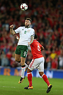 Daryl Murphy of Republic of Ireland (l) jumps for a header over Ashley Williams of Wales. Wales v Rep of Ireland , FIFA World Cup qualifier , European group D match at the Cardiff city Stadium in Cardiff , South Wales on Monday 9th October 2017. pic by Andrew Orchard, Andrew Orchard sports photography