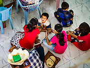 19 NOVEMBER 2017 - HWAMBI, YANGON REGION, MYANMAR: The sanctuary is so full people sit on the floor during mass at Sacred Heart's Catholic Church in Hwambi, about 90 minutes north of Yangon. Catholics in Myanmar are preparing for the visit of Pope Francis. He is coming to the Buddhist majority country November 27-30. There about 500,000 Catholics in Myanmar, about 1% of the population. Catholicism was originally brought to what is now Myanmar more than 500 years ago by Portuguese missionaries and traders.    PHOTO BY JACK KURTZ