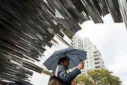 People pass by the Chinese activiest and artist, Ai Weiwei's art project at Washington Square in New York,NY on October 12, 2017.   The artist assembeled 300 establishment around New York City statement  'Good Fences Make Good Neighbors'.  The works can be viewed through February 11, 2018. (Amir Levy/ SIPA USA)