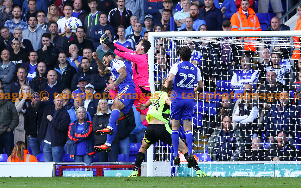 Goalkeeper Danny Ward of Huddersfield Town punches clear under pressure during the Sky Bet Championship match between Ipswich Town and Huddersfield Town at Portman Road in Ipswich. October 1, 2016.<br /> Arron Gent / Telephoto Images<br /> +44 7967 642437