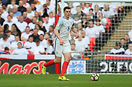Michael Keane of England dribbling and about to pass the ball during the FIFA World Cup Qualifier group stage match between England and Lithuania at Wembley Stadium, London, England on 26 March 2017. Photo by Matthew Redman.