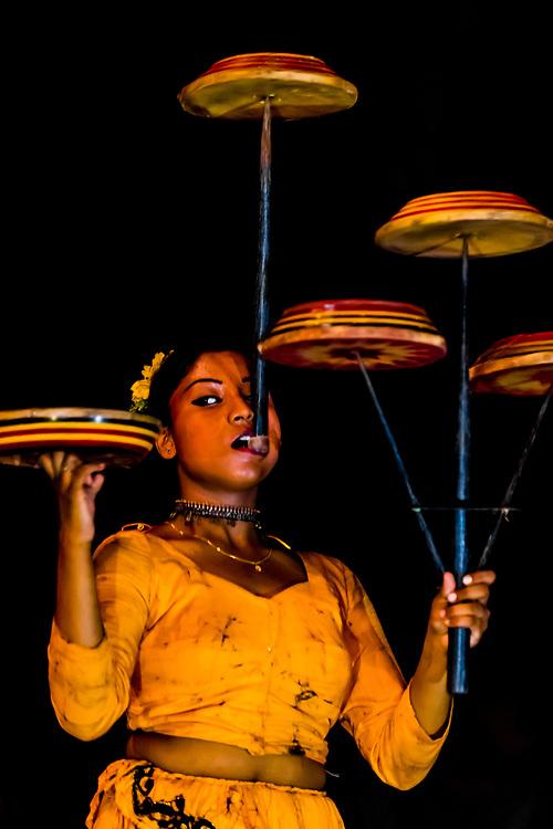 "Balancing spinning disks, ""Dances of Sri Lanka"" cultural performance, Kandy, Central Province, Sri Lanka."