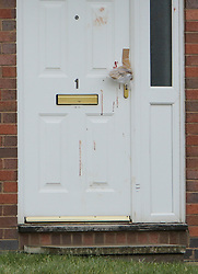 © Licensed to London News Pictures. 24/03/2016. Redcar, UK. Blood on the front door of a property  in Redcar, North Yorkshire, where the bodies of two women where found. A 34-year-old man has been arrested on suspicion of two counts of murder  Photo credit: Stuart Boulton/LNP