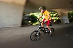 United States, Washington, Redmond, boy on bicycle on Sammamish River Ttrail. MR