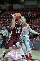 05 January 2014:  Marcus Fillyaw gets inside of Nick Zeisloft and looks for the hoop during an NCAA  mens basketball game between the Salukis of Southern Illinois and the Illinois State Redbirds  in Redbird Arena, Normal IL.  Final score ISU 66, SIU 48
