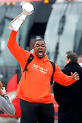 Kansas City Chiefs defensive tackle Chris Jones reacts as he holds up the Lombardi Trophy, as he and his teammates return home a day after winning the NFL Super Bowl 54 football game Monday, Feb. 3, 2020, in Kansas City, MO. The Chiefs defeated the San Francisco 49ers 31-20, to win their first championship in 50 years.  (AP Photo/Colin E. Braley)