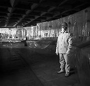 Chernobyl, Ukraine, Ocober 1995..The explosion at the Chernobyl Nuclear Power Plant on April 26 1986 was the worst nuclear accident in history..Security officer Mikhail Luchenko stands in the abandoned control room of Reactor No. 4, all the surfaces of which are shrouded in decontaminated plastic.