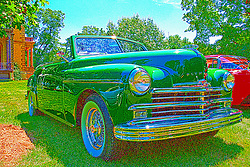 03 August 2013:  1949 Plymouth Special Deluxe convertible<br /> <br /> This image was produced in part utilizing High Dynamic Range (HDR) or panoramic stitching or other computer software manipulation processes. It should not be used editorially without being listed as an illustration or with a disclaimer. It may or may not be an accurate representation of the scene as originally photographed and the finished image is the creation of the photographer.