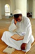 KENYA, LAMU ISLAND Swahili teenager studys Koran in Madrasa