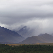 Mist and clouds surround the mountain ranges at Lake Tekapo and  the Mackenzie Country, South Island, New Zealand. 24th February 2011, Photo Tim Clayton
