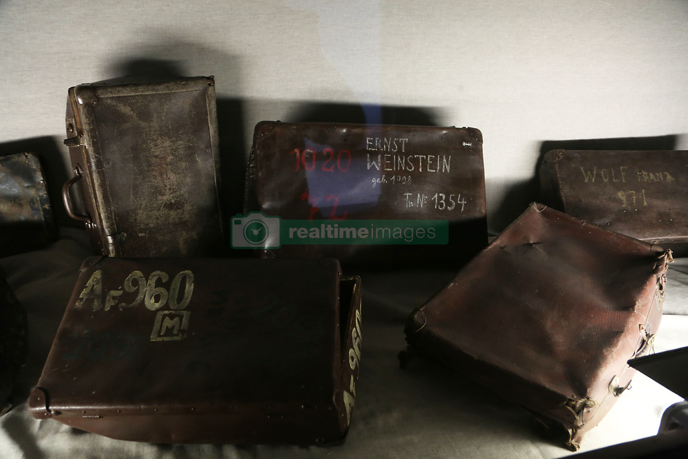 Display case of suitcases used by the victims at Auschwitz-Birkenau Memorial and Museum in Auschwitz, Poland on September 3, 2017. Auschwitz concentration camp was a network of German Nazi concentration camps and extermination camps built and operated by the Third Reich in Polish areas annexed by Nazi Germany during WWII. It consisted of Auschwitz I (the original camp), Auschwitz II–Birkenau (a combination concentration/extermination camp), Auschwitz II–Monowitz (a labor camp to staff an IG Farben factory), and 45 satellite camps. In September 1941, Auschwitz II–Birkenau went on to become a major site of the Nazi Final Solution to the Jewish Question. From early 1942 until late 1944, transport trains delivered Jews to the camp's gas chambers from all over German-occupied Europe, where they were killed en masse with the pesticide Zyklon B. An estimated 1.3 million people were sent to the camp, of whom at least 1.1million died. Around 90 percent of those killed were Jewish; approximately 1 in 6 Jews killed in the Holocaust died at the camp. Others deported to Auschwitz included 150,000 Poles, 23,000 Romani and Sinti, 15,000 Soviet prisoners of war, 400 Jehovah's Witnesses, and tens of thousands of others of diverse nationalities, including an unknown number of homosexuals. Many of those not killed in the gas chambers died of starvation, forced labor, infectious diseases, individual executions, and medical experiments. In 1947, Poland founded a museum on the site of Auschwitz I and II, and in 1979, it was named a UNESCO World Heritage Site. Photo by Somer/ABACAPRESS.COM