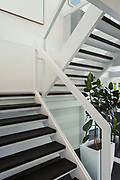 Architecture, open space of a modern house, staircase