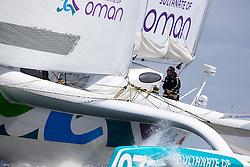 Loik Gallon (FRA) trims the jib. Oman Sail's MOD70 Musandam races in the Eckernförde race at  Kiel week 2014, 21-06-2014, Kiel - Germany.