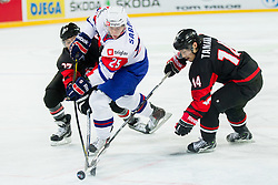 Robert Sabolic of Slovenia between Hiroki Ueno and Go Tanaka of Japan during ice-hockey match between Slovenia and Japan at IIHF World Championship DIV. I Group A Slovenia 2012, on April 16, 2012 in Arena Stozice, Ljubljana, Slovenia. Slovenia defeated Japan 4-2. (Photo by Vid Ponikvar / Sportida.com)