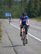 Alaska. Bike racer along the Richardson Highway in the Fireweed 400 race to Valdez, July 2009.