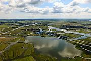 Nederland, Noord-Holland, Gemeente Wormerland, 14-06-2012; Polder Wormer, Jisp en Nek .met de dorpen Wormer (re) en Jisp, in de verte aan het water van 't Zwet. De verkaveling in het gebied is het resultaat van veenontginning..Links richting horizon de Beemster, midden aan de horizon Purmerend met IJsselmeer, midden rechts de droogmakerij De Wijde Wormer (Wijdewormer)..Polder in province North Holland (above Amsterdam) with villages. The division in plots in the area is the result of peat extraction..luchtfoto (toeslag), aerial photo (additional fee required);.copyright foto/photo Siebe Swart