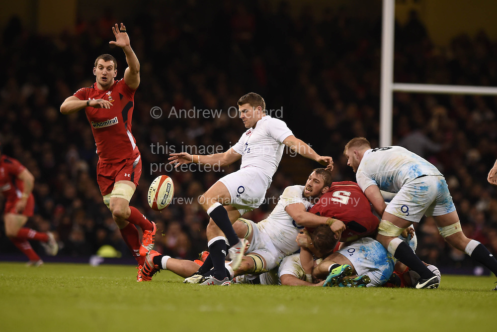 Sam Warburton of Wales attempts to charge down the kick from England's Richard Wigglesworth. RBS Six nations championship 2015, Wales v England at the Millennium Stadium in Cardiff, South Wales on Friday 6th  Feb 2015. pic by Andrew Orchard, Andrew Orchard sports photography.
