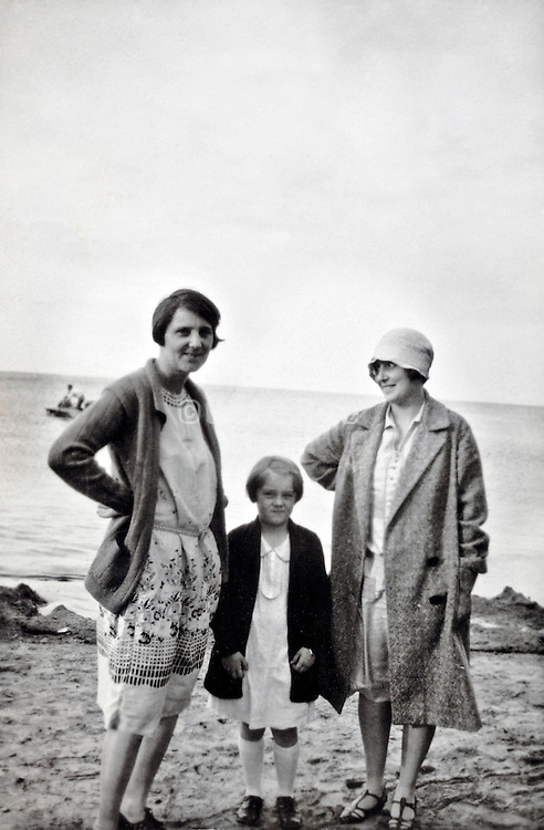 mother posing with child and friend