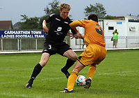 Photo: Rich Eaton.<br /> <br /> Carmarthen Town v SK Brann. UEFA Cup Qualifying. 19/07/2007. SK Brann's Bjorn Dahl (l) tries to get past Carmarthen's Neil Smothers (r).