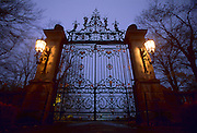 USA Newport, RI - Gates of Belcourt castle on foggy night, Low wide angle view.
